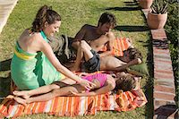 Family relaxing on holiday Stock Photo - Premium Royalty-Freenull, Code: 6114-06656807