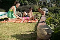 Family relaxing on holiday Stock Photo - Premium Royalty-Freenull, Code: 6114-06656846