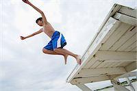Boy jumping Stock Photo - Premium Royalty-Freenull, Code: 6114-06657136