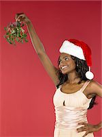 Woman holding mistletoe Stock Photo - Premium Royalty-Freenull, Code: 6114-06657520