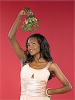 Woman holding mistletoe Stock Photo - Premium Royalty-Freenull, Code: 6114-06657537