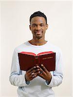 Man holding a bible Stock Photo - Premium Royalty-Freenull, Code: 6114-06657851