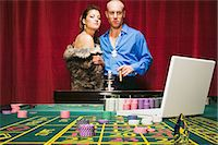 Man risking his wealth on the roulette table Stock Photo - Premium Royalty-Freenull, Code: 6114-06658570