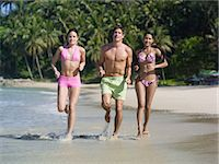 southeast asian - Men and women running on the beach Stock Photo - Premium Royalty-Freenull, Code: 6114-06658704