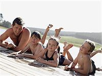 Family lying on a pier Stock Photo - Premium Royalty-Freenull, Code: 6114-06659035