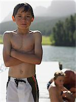 Boy standing on a pier Stock Photo - Premium Royalty-Freenull, Code: 6114-06659048