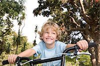 Boy riding a bike Stock Photo - Premium Royalty-Freenull, Code: 6114-06659253