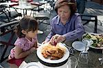 Girl and grandmother having a meal Stock Photo - Premium Royalty-Free, Artist: foodanddrinkphotos, Code: 6114-06659273