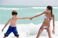 preteen bikini - Brother and sister by the sea Stock Photo - Premium Royalty-Freenull, Code: 6114-06659330