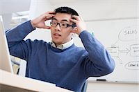 people in panic - Man having a crisis at work Stock Photo - Premium Royalty-Freenull, Code: 6114-06659411