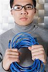 Man holding network cable Stock Photo - Premium Royalty-Free, Artist: Albert Normandin, Code: 6114-06659431