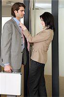 Woman adjusting mans tie Stock Photo - Premium Royalty-Freenull, Code: 6114-06659467