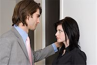flirting - Couple standing face to face in office corridor Stock Photo - Premium Royalty-Freenull, Code: 6114-06659477