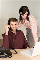 secretary desk - Man and woman at office desk Stock Photo - Premium Royalty-Freenull, Code: 6114-06659490