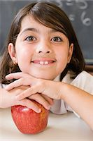 Girl with an apple Stock Photo - Premium Royalty-Freenull, Code: 6114-06659962