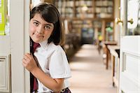 Girl in a library Stock Photo - Premium Royalty-Freenull, Code: 6114-06659974