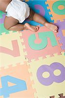 Baby boy crawling Stock Photo - Premium Royalty-Freenull, Code: 6114-06660663