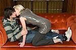 Teenagers kissing on a sofa Stock Photo - Premium Royalty-Freenull, Code: 6114-06660832