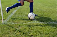 Footballer taking a corner kick Stock Photo - Premium Royalty-Freenull, Code: 6114-06660935