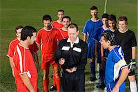 Referee tossing coin Stock Photo - Premium Royalty-Freenull, Code: 6114-06660946