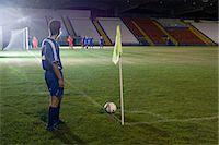 Footballer taking a corner kick Stock Photo - Premium Royalty-Freenull, Code: 6114-06660949