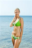 Young woman by the sea Stock Photo - Premium Royalty-Freenull, Code: 6114-06661529