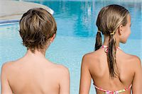 Boy and girl at a swimming pool Stock Photo - Premium Royalty-Freenull, Code: 6114-06661706