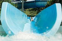 Girl on a water slide Stock Photo - Premium Royalty-Freenull, Code: 6114-06661707