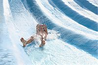 Girl on a water slide Stock Photo - Premium Royalty-Freenull, Code: 6114-06661724