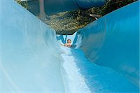 Girl on a water slide Stock Photo - Premium Royalty-Freenull, Code: 6114-06661725