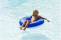 Boy in a swimming pool Stock Photo - Premium Royalty-Freenull, Code: 6114-06661733