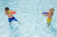 Boys with water pistols Stock Photo - Premium Royalty-Freenull, Code: 6114-06661753