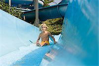 Boy on a water slide Stock Photo - Premium Royalty-Freenull, Code: 6114-06661754