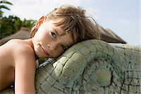 Boy on a model crocodile Stock Photo - Premium Royalty-Freenull, Code: 6114-06661755