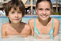 Boy and girl in a swimming pool Stock Photo - Premium Royalty-Freenull, Code: 6114-06661756