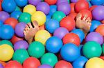 Feet in a ball pool Stock Photo - Premium Royalty-Free, Artist: Robert Harding Images, Code: 6114-06661757