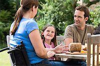 Family dining al fresco Stock Photo - Premium Royalty-Freenull, Code: 6114-06661824
