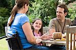 Family dining al fresco Stock Photo - Premium Royalty-Free, Artist: Elizabeth Knox, Code: 6114-06661824
