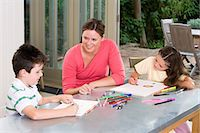 Mother watching children draw Stock Photo - Premium Royalty-Freenull, Code: 6114-06661826