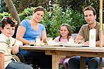 Familiy dining al fresco Stock Photo - Premium Royalty-Free, Artist: Pierre Tremblay, Code: 6114-06661829