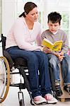 Mother helping son read book Stock Photo - Premium Royalty-Free, Artist: Aflo Relax, Code: 6114-06661852