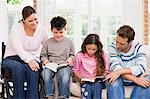 Parents helping their children read Stock Photo - Premium Royalty-Free, Artist: Elizabeth Knox, Code: 6114-06661858