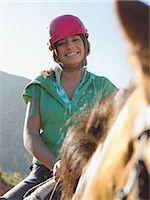 Teenage girl riding horse Stock Photo - Premium Royalty-Freenull, Code: 6114-06662014