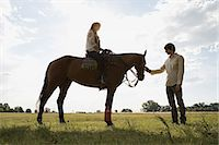 Couple with a horse Stock Photo - Premium Royalty-Freenull, Code: 6114-06662395