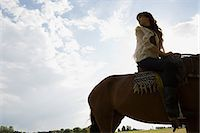 Young woman riding horse Stock Photo - Premium Royalty-Freenull, Code: 6114-06662411