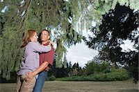 Man grabbing wife's bottom in the woods Stock Photo - Premium Royalty-Freenull, Code: 6114-06663105