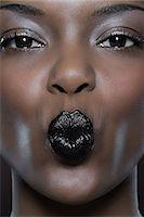 Woman puckering up Stock Photo - Premium Royalty-Freenull, Code: 6114-06663309