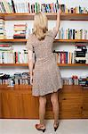 Woman taking book from shelf Stock Photo - Premium Royalty-Free, Artist: ableimages, Code: 6114-06663391