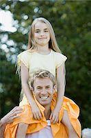 preteen girl - Man shoulder carrying his daughter Stock Photo - Premium Royalty-Freenull, Code: 6114-06663659
