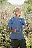 preteen long hair - Boy standing in an overgrown field Stock Photo - Premium Royalty-Freenull, Code: 6114-06663666